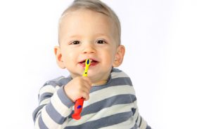 young boy with toothbrush