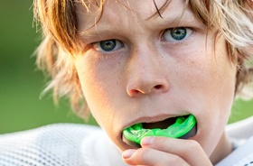 A young boy wearing a mouthguard while playing sports