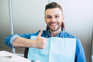 Man at appointment to maximize dental insurance benefits